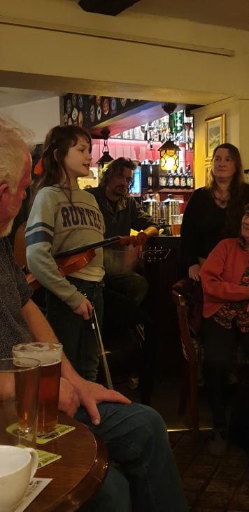 Ceri telling Dick the Fiddler